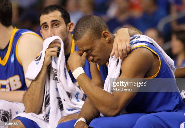 Jordan Weiner and Justin Joyner of the UC Santa Barbara Gauchos sit on the bench dejected late in the second half of their 7951 loss against the...