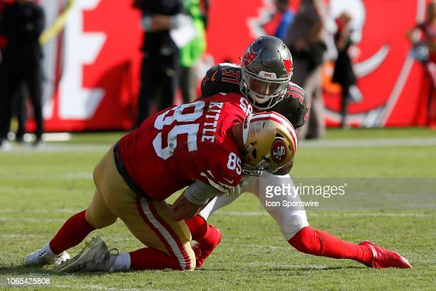 Jordan Whitehead of the Bucs brings down George Kittle of the 49ers during the regular season game between the San Francisco 49ers and the Tampa Bay...