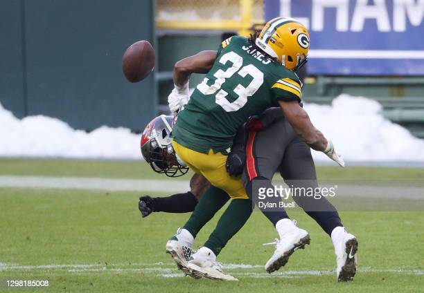 Jordan Whitehead of the Tampa Bay Buccaneers forces a fumble by Aaron Jones of the Green Bay Packers in the third quarter during the NFC Championship...