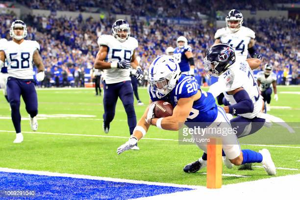 Jordan Wilkins of the Indianapolis Colts dives for a touchdown in the game against the Tennessee Titans in the second quarter at Lucas Oil Stadium on...