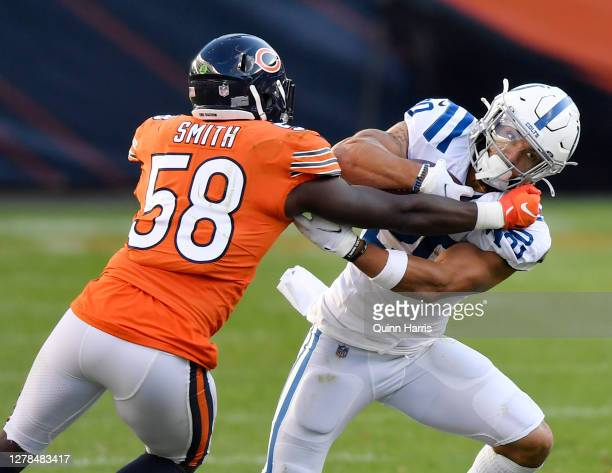 Jordan Wilkins of the Indianapolis Colts is tackled in the second quarter by Roquan Smith of the Chicago Bears at Soldier Field on October 04, 2020...