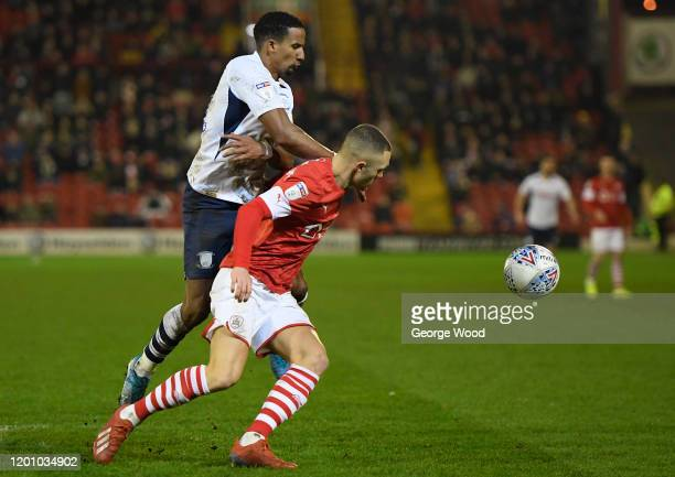 Jordan Williams of Barnsley battles for possession with Scott Sinclair of Preston North End during the Sky Bet Championship match between Barnsley...