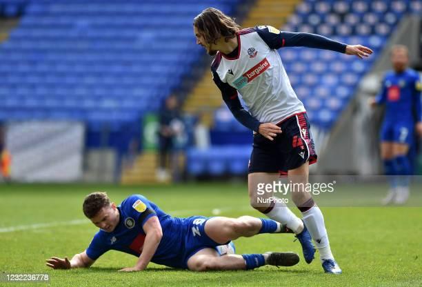 Jordan Williams of Bolton Wanderers tussles Josh McPake of Harrogate Town during the Sky Bet League 2 match between Bolton Wanderers and Harrogate...