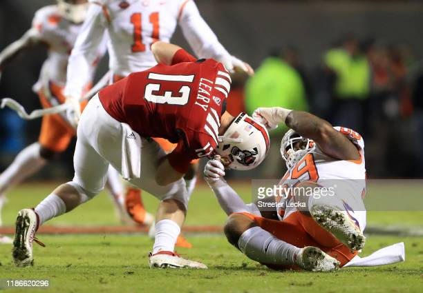 Jordan Williams of the Clemson Tigers sacks Devin Leary of the North Carolina State Wolfpack during their game at CarterFinley Stadium on November 09...