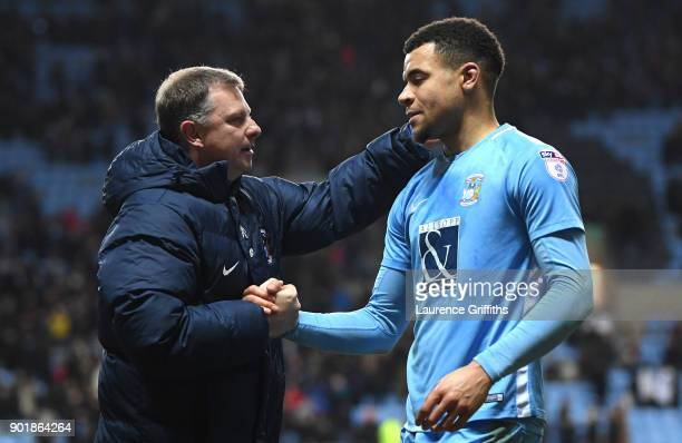 Jordan Willis of Coventry City and Mark Robins manager of Coventry City embrace during the The Emirates FA Cup Third Round match between Coventry...