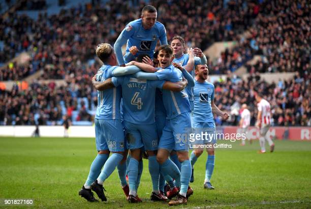 Jordan Willis of Coventry City celebrates after scoring his sides first goal with team mates during The Emirates FA Cup Third Round match between...
