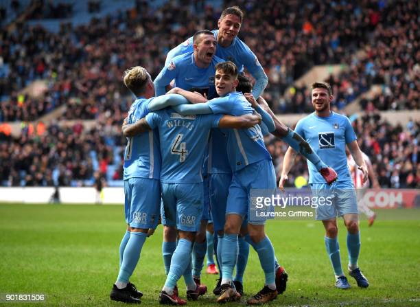 Jordan Willis of Coventry City celebrates with teammates after scoring his sides first goal during The Emirates FA Cup Third Round match between...