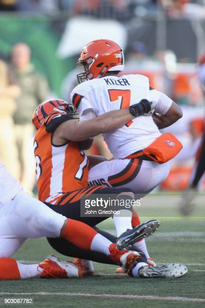 Jordan Willis of the Cincinnati Bengals makes the hit on DeShone Kizer of the Cleveland Browns during their game at Paul Brown Stadium on November 26...