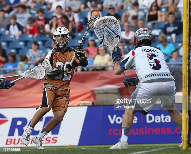 Jordan Wolf of Rochester Rattlers shoots on Jordan Burke of Boston Cannons in the second period at Gillette Stadium on May 17 2013 in Foxboro...