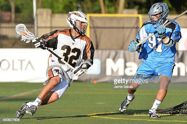 Jordan Wolf of the Rochester Rattlers controls the ball in the fourth quarter as Dana Wilber of the Ohio Machine defends on June 14, 2014 at Selby...