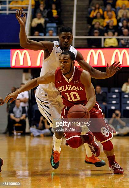 Jordan Woodard of the Oklahoma Sooners drives the ball down court against the West Virginia Mountaineers during the game at the WVU Coliseum on...