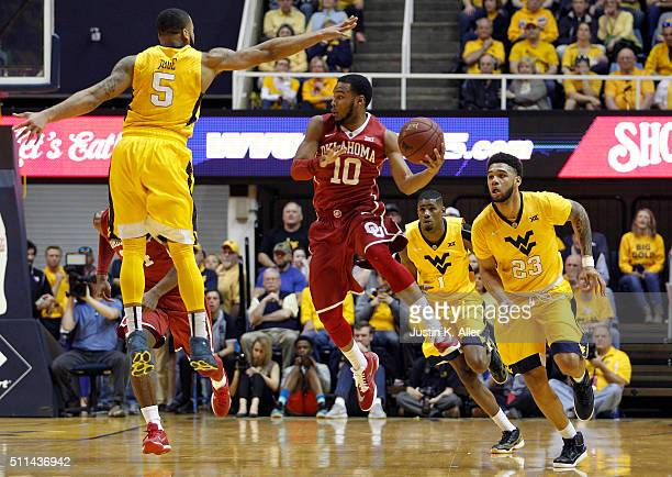 Jordan Woodard of the Oklahoma Sooners looks to pass during the game against Jaysean Paige of the West Virginia Mountaineers at the WVU Coliseum on...