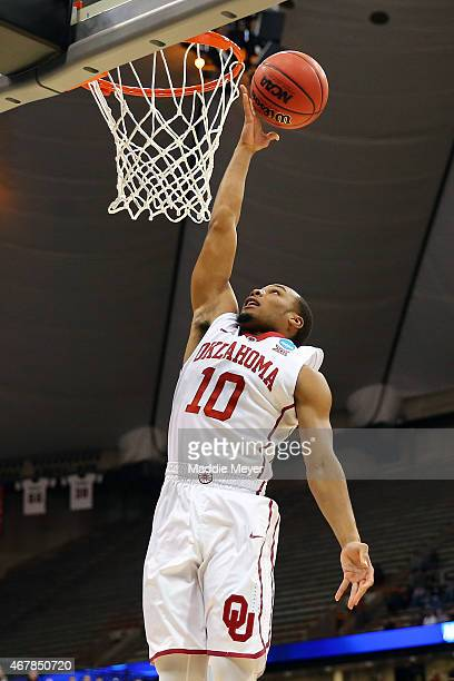 Jordan Woodard of the Oklahoma Sooners shoots the ball against the Michigan State Spartans in the first half of the game during the East Regional...