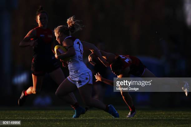 Jordan Zanchetta of the Lions is tackled by Lily Mithen of the Demons during the round five AFLW match between the Melbourne Demons and the Brisbane...