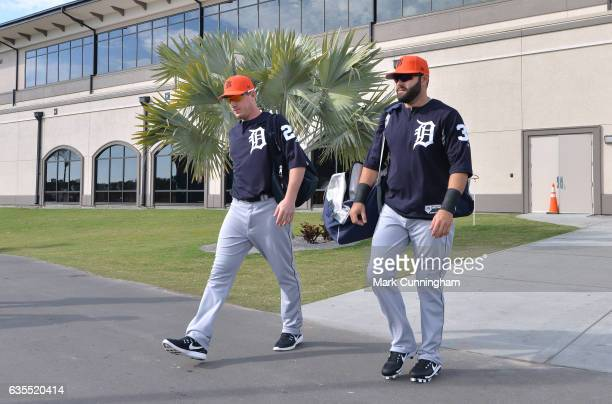 Jordan Zimmermann and Alex Avila of the Detroit Tigers walk from the clubhouse to the field during Spring Training workouts at the TigerTown complex...