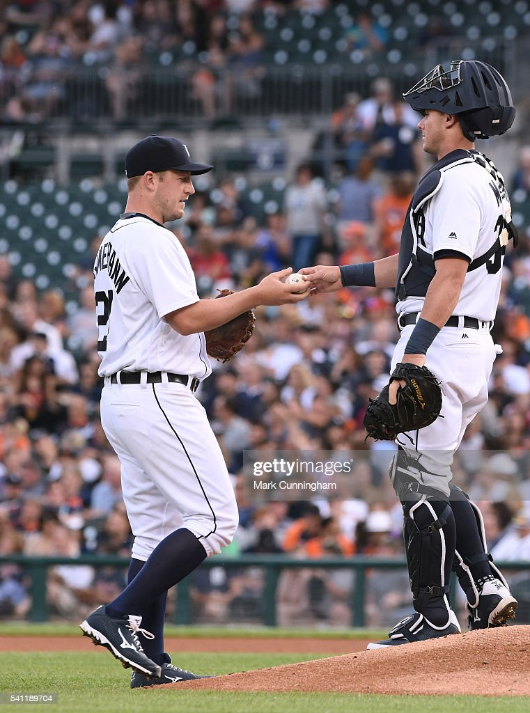 Jordan Zimmermann #27 (L) and James McCann #34 of the Detroit Tigers stand together on the pitchers mound whle wearing Mizuno shoes and gloves during the game against the Chicago White Sox at Comerica Park on June 3, 2016 in Detroit, Michigan. The Tigers defeated the White Sox 10-3.