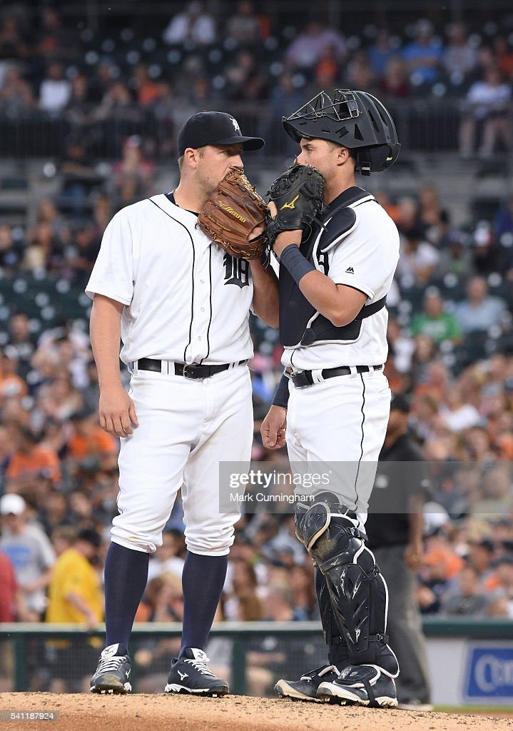 Jordan Zimmermann #27 (L) and James McCann #34 of the Detroit Tigers talk on the pitchers mound whle wearing Mizuno shoes and gloves during the game against the Chicago White Sox at Comerica Park on June 3, 2016 in Detroit, Michigan. The Tigers defeated the White Sox 10-3.