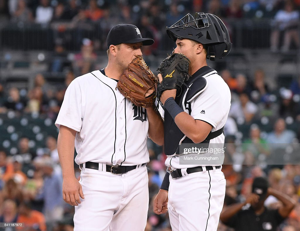 Jordan Zimmermann #27 (L) and James McCann #34 of the Detroit Tigers talk on the pitchers mound whle wearing Mizuno gloves during the game against the Chicago White Sox at Comerica Park on June 3, 2016 in Detroit, Michigan. The Tigers defeated the White Sox 10-3.