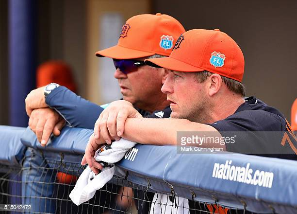 Jordan Zimmermann and pitching coach Rich Dubee of the Detroit Tigers look on from the dugout during the Spring Training game against the Washington...