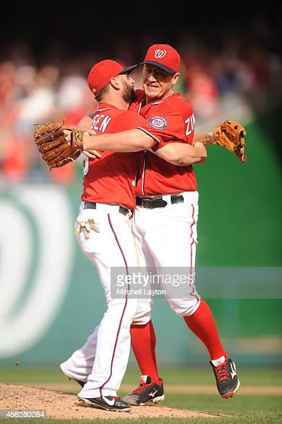 Jordan Zimmermann of the Washington Nationals celebrates his nohitter with Kevin Frandsen after a baseball game against the Miami Marlins on...