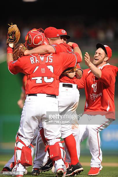 Jordan Zimmermann of the Washington Nationals celebrates his nohitter with WIlson Ramos and Bryce Harper after a baseball game against the Miami...