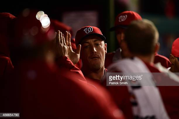 Jordan Zimmermann of the Washington Nationals celebrates with his teammates in the dugout after being relieved in the ninth inning against the San...
