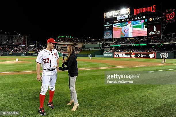 Jordan Zimmermann of the Washington Nationals talks with MASN's sideline reporter Julie Alexandria after the Nationals defeated the Cincinnati Reds...