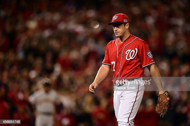 Jordan Zimmermann of the Washington Nationals walks back to the dugout after being relieved in the ninth inning against the San Francisco Giants...