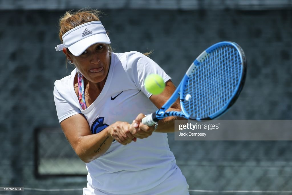 Jordana Lujan along with teammate Samantha Echevarria of the West Florida Argonauts returns a ball against Zuca Maciejewska and Carolin Schmidt of the Barry Buccaneers during the Division II Women's Tennis Championship held at the Surprise Tennis & Racquet Club on May 11, 2018 in Surprise, Arizona.