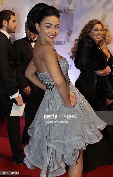 Jordanian actress Mais Hamdan arrives to attend the Adonia Awards party in Damascus late on November 26 2010 AFP PHOTO/LOUAI BESHARA