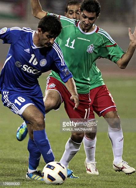 Jordanian AlWehdat's Abdullah Dib challenges Artyom Filiposyan of Uzbekistan's Nasaf during their AFC Cup second leg semifinal football match in...