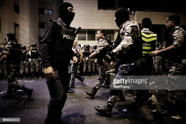 Jordanian antiriot police guard the prime minister's office during a demonstration against a draft income tax law in Amman Jordan on Wednesday June 6...