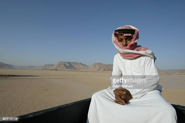 Jordanian bedouin child sits on a truck during a camel race in the desert of Wadi Rum on August 22 2008 in Jordan Jordanian and Saudi bedouins...
