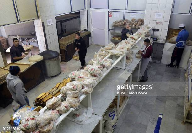Jordanian buy bread from a bakery in the Jordanian capital Amman on January 27 2018 Jordan's Minister of Industry announced the decision to raise the...
