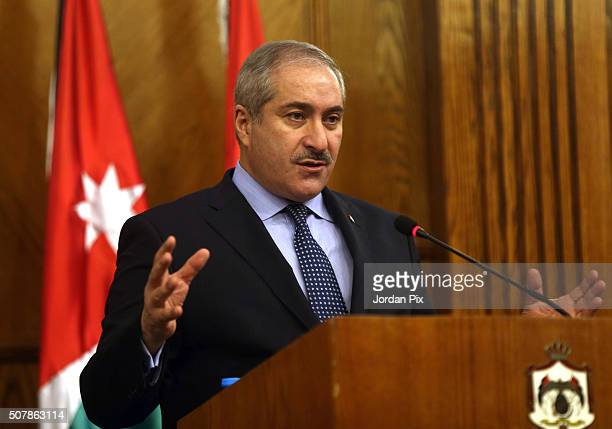 Jordanian counterpart Nasser Judeh attends a joint press conference with British Foreign Secretary Philip Hammond on February 1 2016 in Amman Jordan...