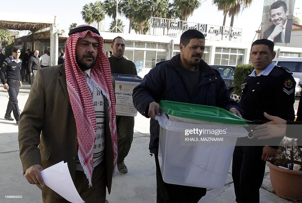Jordanian election officials carry ballot boxes to be distributed to polling stations in Amman on January 22, 2013 on the eve of a general election. Jordanians will go to the polls for the second election in two years, again boycotted by Islamists and expected to produce yet another opposition-free parliament, casting doubt on the prospects for political reform.