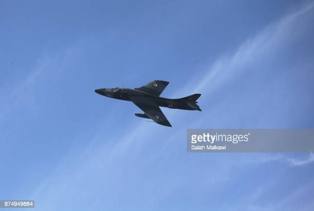 Jordanian F16 jet peforms during a special celebration as Aqaba authorities in Jordan sink the body of a military transport C130 Hercules plane which...