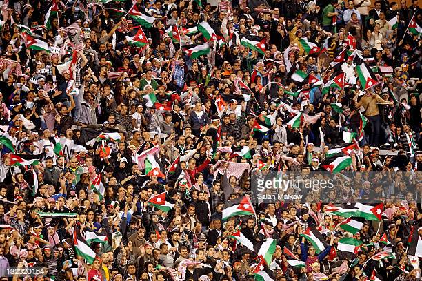 Jordanian fans celebrate their team's first goal against Singapore during the 2014 FIFA World Cup qualifying Asian Group A match between Jordan and...