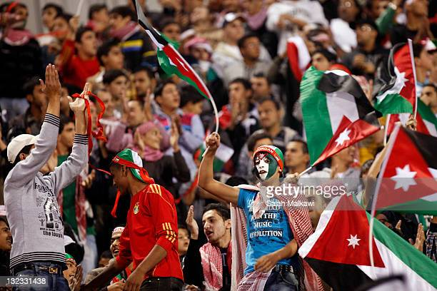 Jordanian fans encourage their national football team during the 2014 FIFA World Cup qualifying Asian Group A match between Jordan and Singapore at...