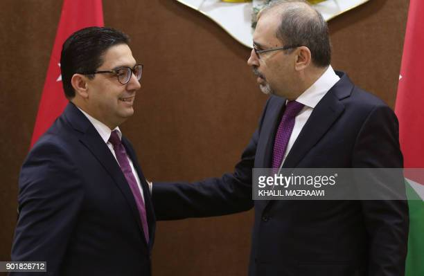 Jordanian Foreign Minister Ayman Safadi greets his Moroccan counterpart Nasser Bourita in the Jordanian capital Amman on January 6 2018 The foreign...