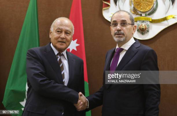 Jordanian Foreign Minister Ayman Safadi shakes hands with Arab League chief Ahmed Abul Gheit during a meeting in the Jordanian capital Amman on...