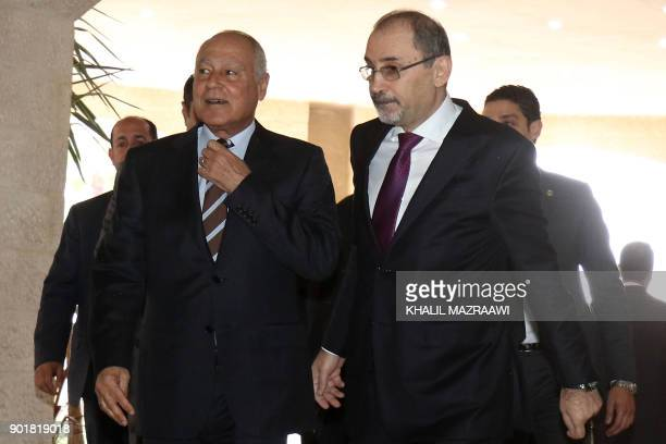 Jordanian Foreign Minister Ayman Safadi walks next to Arab League chief Ahmed Abul Gheit following a meeting in the Jordanian capital Amman on...