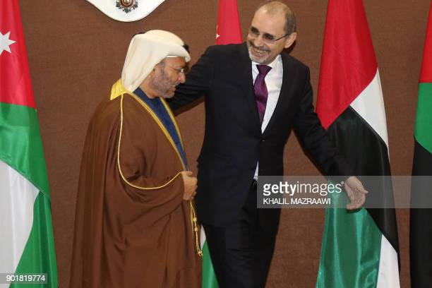 Jordanian Foreign Minister Ayman Safadi walks next to UAE Minister of State for Foreign Affairs Anwar Gargash following a meeting in the Jordanian...