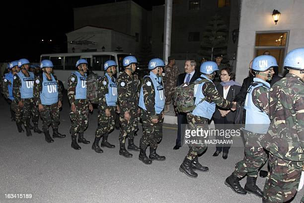 Jordanian Foreign Minister Nasser Judeh greets United Nations peacekeepers upon their arrival at the Jordanian army headquarters for a press...