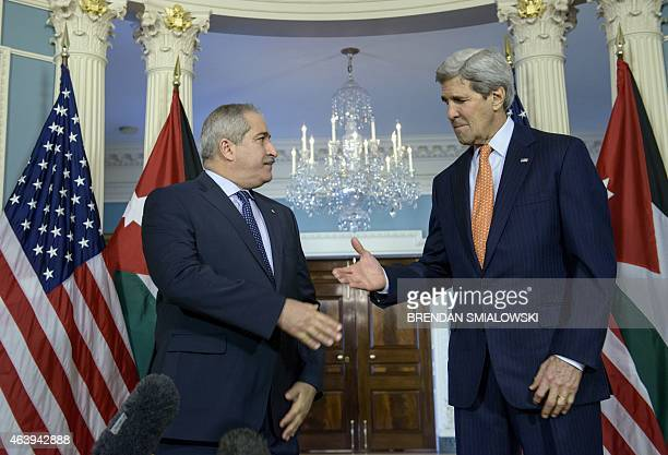 Jordanian Foreign Minister Nasser Judeh US Secretary of State John Kerry shake hands before a meeting at the US State Department February 20 2015 in...