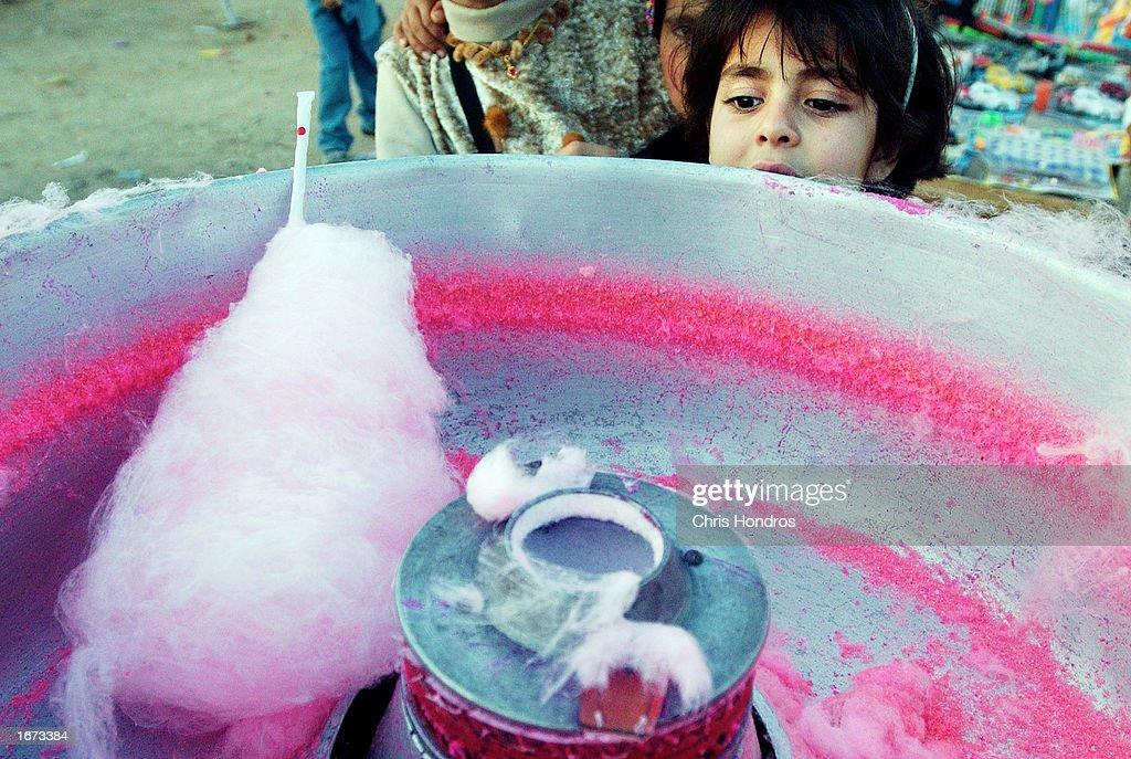 Good Jordan Eid Al-Fitr Food - jordanian-girl-waits-for-a-serving-of-cotton-candy-on-the-first-day-picture-id1673384?k\u003d6\u0026m\u003d1673384\u0026s\u003d612x612\u0026w\u003d0\u0026h\u003dANDh2kwSOrr7bzpxg2XplELuB179Bxfvd3Rwr1jmst8\u003d  Gallery_53179 .com/photos/jordanian-girl-waits-for-a-serving-of-cotton-candy-on-the-first-day-picture-id1673384?k\u003d6\u0026m\u003d1673384\u0026s\u003d612x612\u0026w\u003d0\u0026h\u003dANDh2kwSOrr7bzpxg2XplELuB179Bxfvd3Rwr1jmst8\u003d