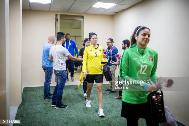 Jordanian Goalkeeper Salma Ghazal defender Haya Khalil followed by the rest of the National Womens Football team are being welcomed with flowers and...