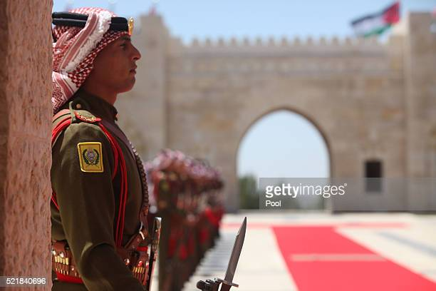 Jordanian honor guard stand for the arrival of Singapore's Prime Minister Lee Hsien at the AlHusseineyah palace on April 17 2016 in Amman Jordan
