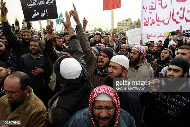 Jordanian Islamists shout slogans during a march in front of the Prime Minster office in Amman on March 6 2011 as hundreds rallied demanding release...