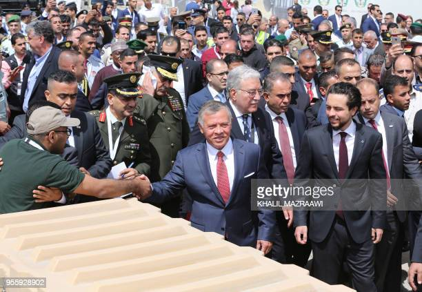 TOPSHOT Jordanian King Abdullah II greets the public as he arrives at the opening of the Special Operations Forces Exhibition and Conference in the...